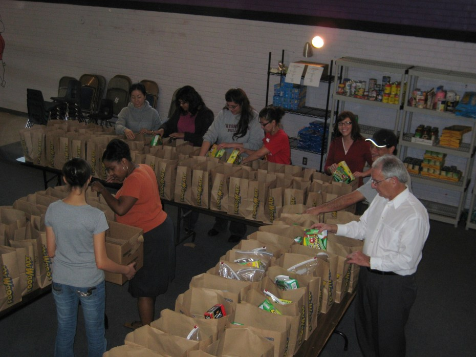 Student Affairs staff volunteer packing bags Friday afternoon