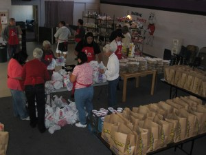 Student Affairs Staff volunteer passing out groceries to families at on Saturday, April 11th